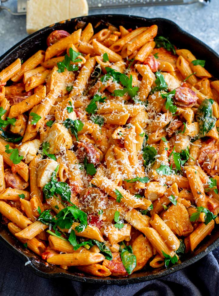 overhead view of a cast iron skillet with chicken chorizo pasta in it