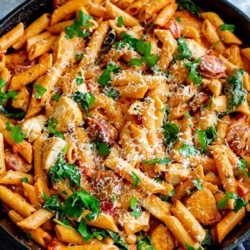square picture of a cast iron skillet of pasta