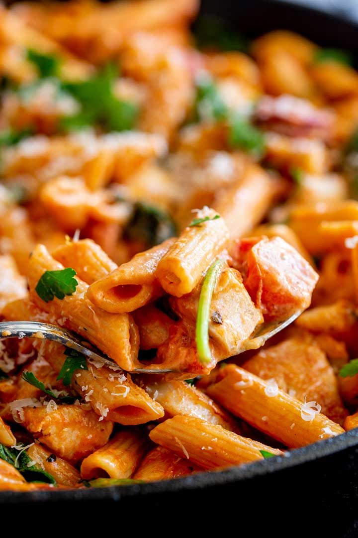 a spoon stopping up chicken pasta