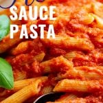 A Fork in a bowl of Red Sauce Pasta with text at the top