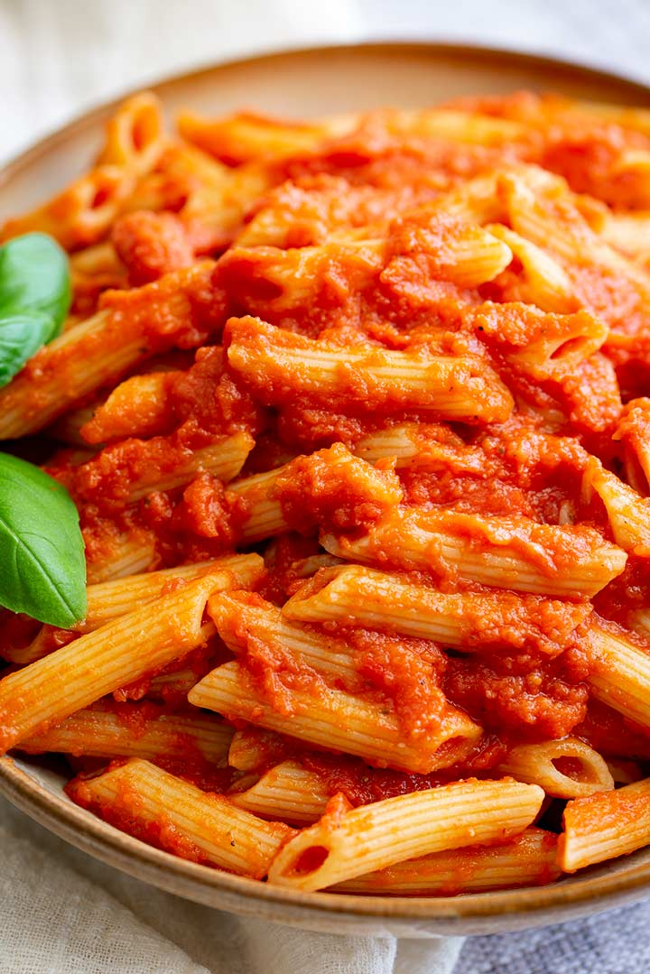 close up on the red sauce pasta, showing the penne and the tomato sauce