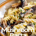 close up on mushroom pasta with text at the bottom
