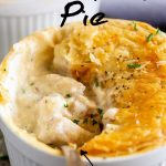 a spoon lifting up the creamy fish filling from a pot pie, with text at the top and bottom