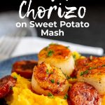 a blue plate of scallops and chorizo on sweet potato mash with text at the top