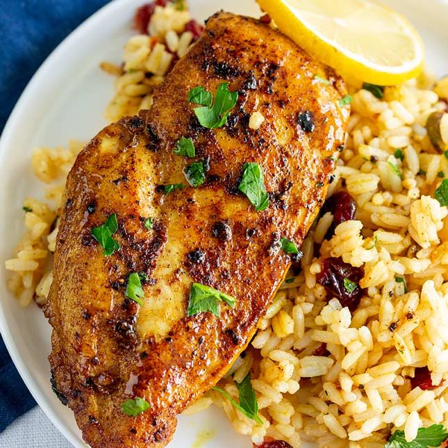 overhead shot of a golden red Persian Chicken breast on a bed of rice