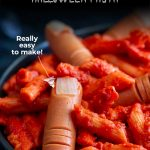 close up on the hotdog severed fingers in this halloween pasta with text at the top