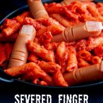 a black bowl of red pasta with hotdog fingers in it with text at the bottom