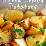 close up on greek potatoes with text at the top