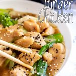 chopsticks picking up a piece of ginger chicken with text at the top