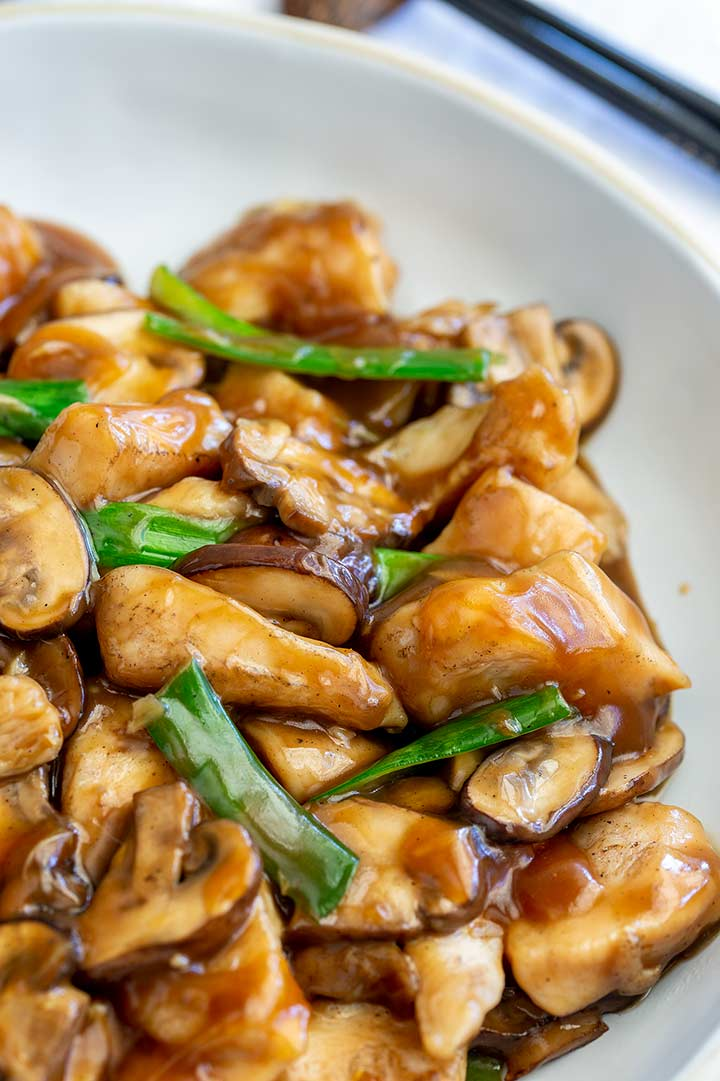 close up on the pieces of chicken in the Chinese chicken and mushroom