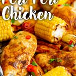peri peri chicken on a sheet pan with veggies with text at the top and bottom