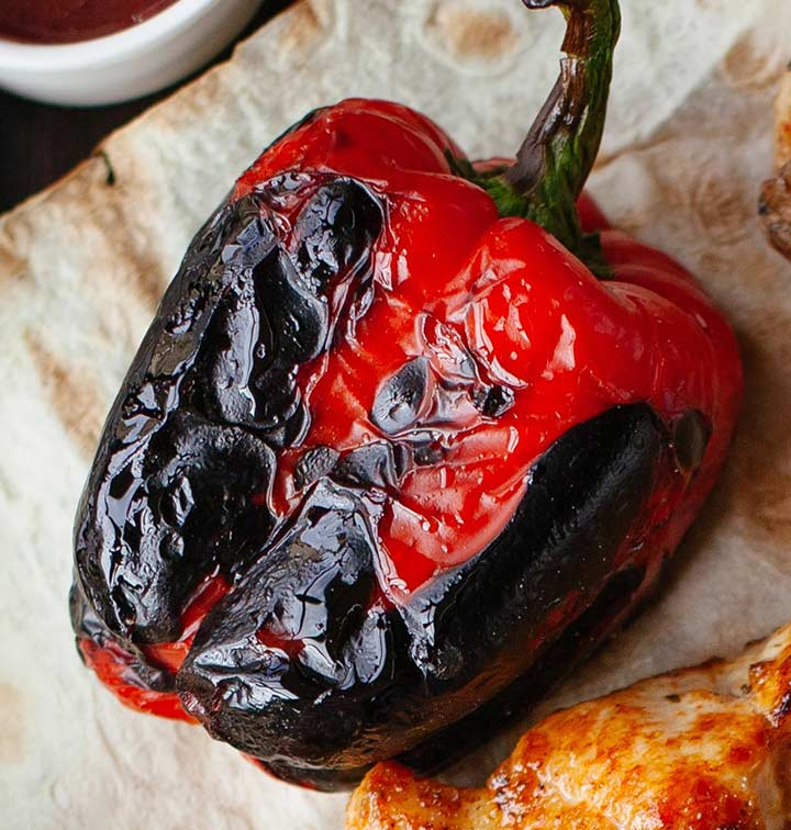 close up on a charred bell pepper