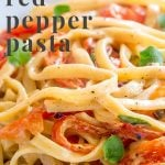 close up on roasted red pepper pasta with text at the top