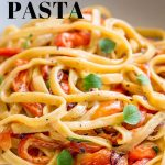 close up on roasted red pepper pasta with text at the top and bottom
