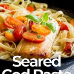 cooked fillet of cod on a bed of pasta with text at the bottom
