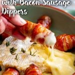 a hand dipping a bacon wrapped sausage into Baked Brie with text at the top and bottom