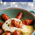 a bacon wrapped sausage sitting in melted brie with text at the top