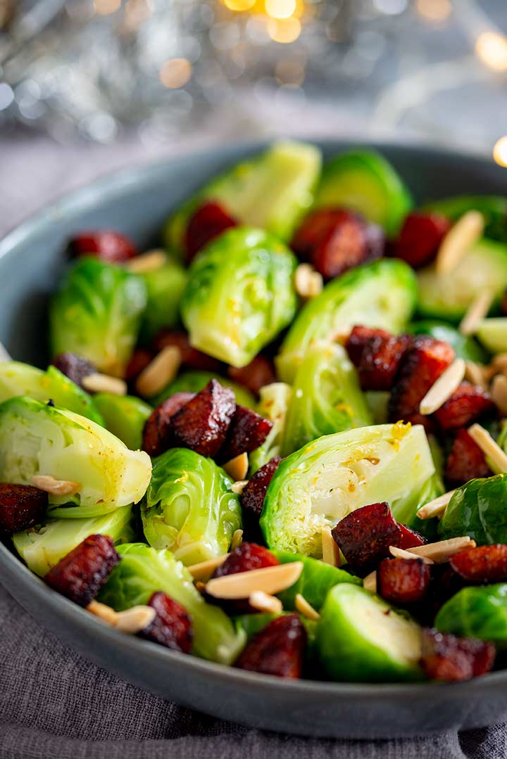 close up on the almonds and chorizo in a bowl of brussel sprouts
