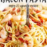 a fork swirling shrimp spaghetti with text at the top