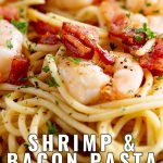 close up on the shrimp in the pasta with text at the bottom