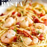 close up of shrimp pasta with text at the top and bottom
