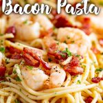 close up on a shrimp with bacon and pasta. Text at the top and bottom