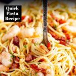 a fork twirling shrimp bacon spaghetti with text at the top