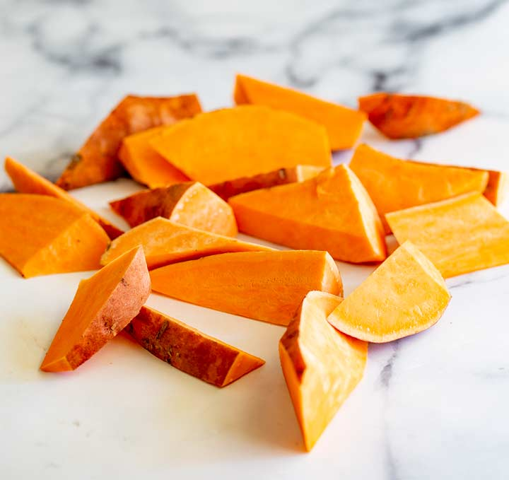 chunks of sweet potato on a marble countertop