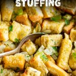 a spoon scooping up classic stuffing with text at the top