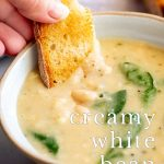 bread dipping into bean soup with text at the bottom