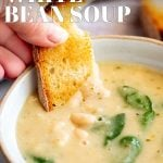 bread dipping into bean soup with text at the top and bottom