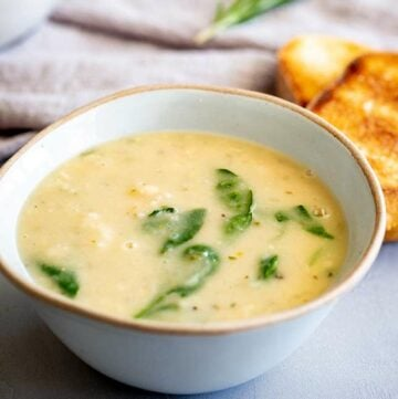 a rustic bowl of creamy soup with spinach