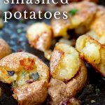 close up of fried smashed potatoes with text at the top
