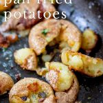 close up on fried skillet potatoes with text at the top
