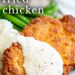 white gravy on chicken fried chicken with text at the top