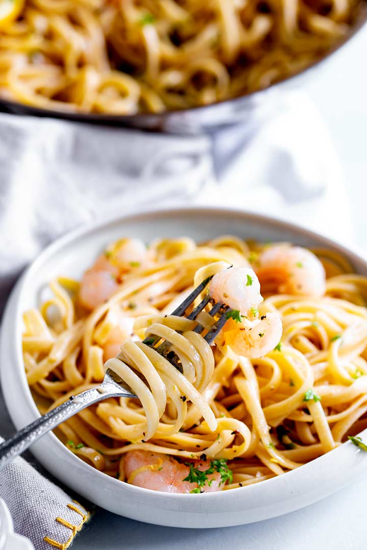 a fork swirling pasta from a shrimp pasta