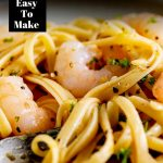 close up on lemon pepper shrimp pasta with text at the top