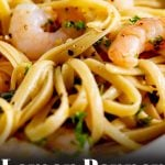 a bowl of shrimp pasta with text at the bottom