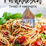 a fork swirling tomato olive spaghetti with text at the top