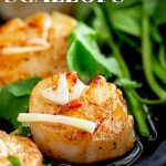 close up on a seared Thai scallop with text at the top and bottom