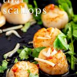 Thai scallop in a cast iron skillet with text at the top