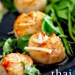 close up on a seared Thai scallop with text at the bottom