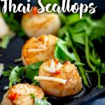 cast iron pan of Thai scallop with text at the top and bottom
