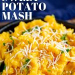 close up of sweet potato mash with shredded coconut on top with text at the top and bottom