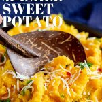 a wooden spoon in a bowl of Thai sweet potato mash with text at the top and bottom