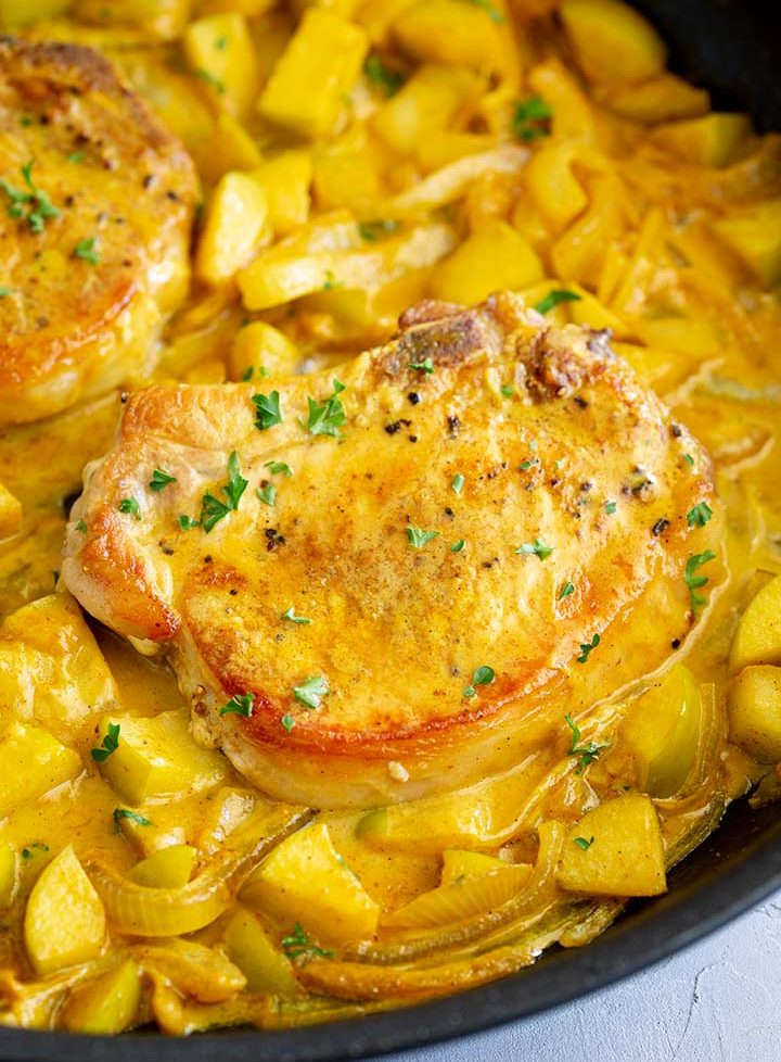 close up on a pan fried curried pork chop