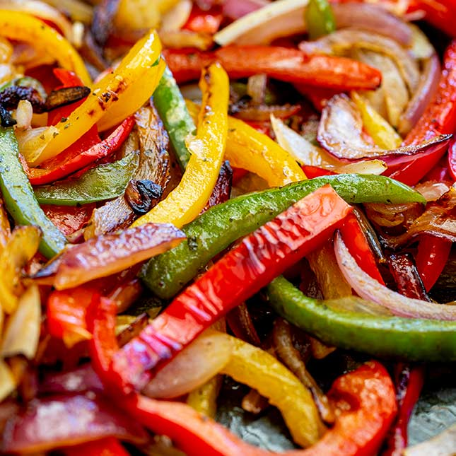 close up of the charred fajita vegetables