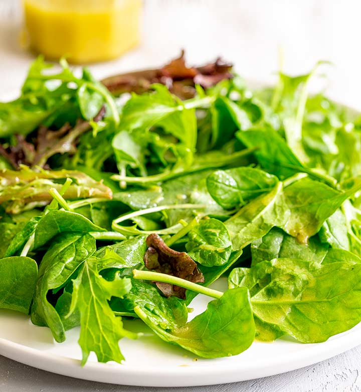 a plate of dressed salad leaves