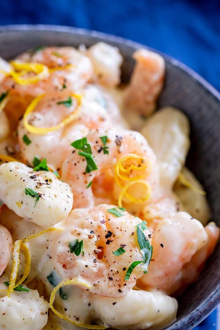 Lemon Shrimp and creamy gnocchi in a small grey bowl