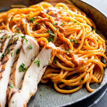 a square close up of the spaghetti in a red pepper sauce